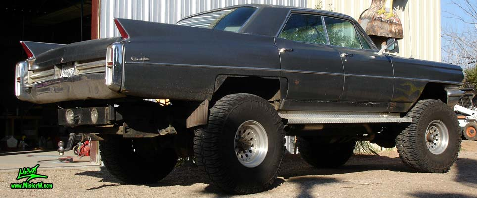 Photo of a 63 Cadillac Sedan deVille that was custom lifted & turned into a 4 Wheel Drive Off Road 4x4 Car. Lifted 63 Caddy 4x4 Car