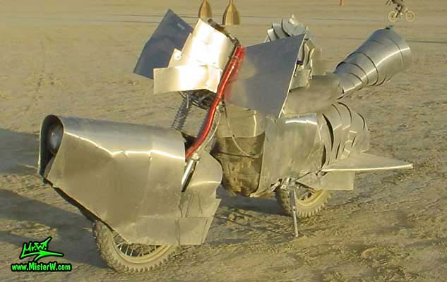 Photo of a silver Art Bike / Mutant Vehicle in Black Rock City, Nevada, 2004. Silver Mutant Art Bike