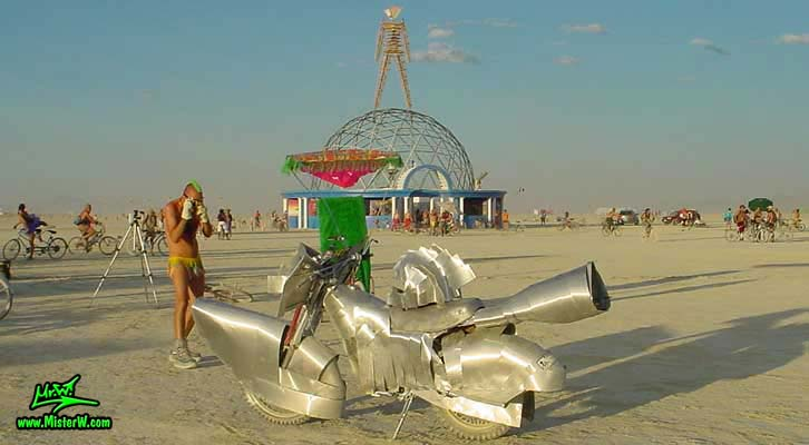 Photo of a silver Art Bike / Mutant Vehicle in Black Rock City, Nevada, 2004. Silver Mutant Art Motorcycle