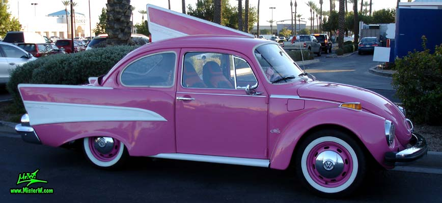 Photo of a mutated VW Bug Art Car that has the tailfins of a 57 Chevy at the Scottsdale Pavilions Classic Car Show in Arizona. Pink 57 Chevy Bug Peter Piper Pizza Delivery Car