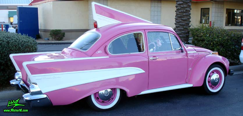 Photo of a mutated VW Bug Art Car that has the tailfins of a 57 Chevy at the Scottsdale Pavilions Classic Car Show in Arizona. The pink 1957 Chevrolet Bug Art Car used to be a Peter Piper Pizza Delivery Car
