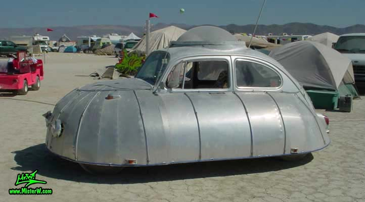 Photo of a silver Flying Saucer Volkswagen, VW UFO Bug, Art Car / Mutant Vehicle in Black Rock City, Nevada, 2002. VW UFO - Flying Saucer Volkswagen - Side View