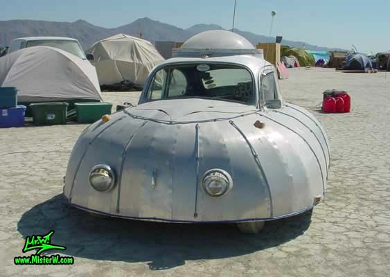 Photo of a silver Flying Saucer Volkswagen, VW UFO Bug, Art Car / Mutant Vehicle in Black Rock City, Nevada, 2002. VW UFO - Flying Saucer Volkswagen - Front View