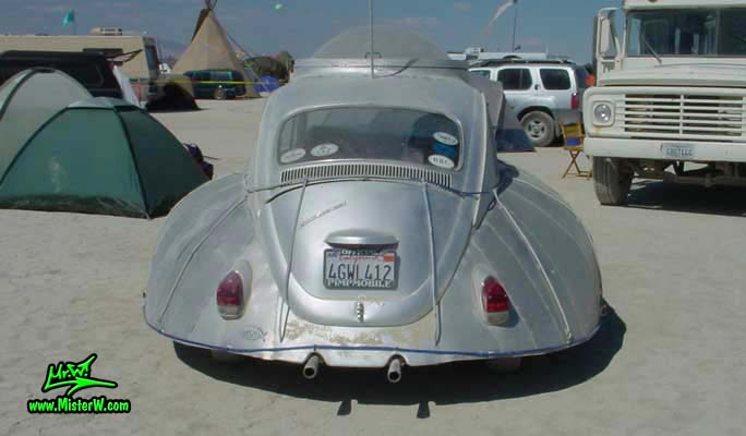 Photo of a silver Flying Saucer Volkswagen, VW UFO Bug, Art Car / Mutant Vehicle in Black Rock City, Nevada, 2002. VW UFO - Flying Saucer Volkswagen - Rear View