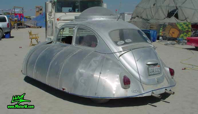 Photo of a silver Flying Saucer Volkswagen, VW UFO Bug, Art Car / Mutant Vehicle in Black Rock City, Nevada, 2002. VW UFO - Flying Saucer Volkswagen - Art Car