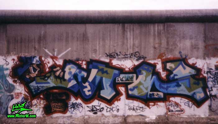 "Photo of a Mr.W graffiti painting by Werner ""Mr.W"" Skolimowski & a graffiti character by B.Base at the Berlin Wall in West-Berlin, 1989. Mr.W Graffiti At The Berlin Wall"