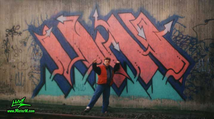 "Photo of Werner ""Mr.W"" Skolimowski in front of his old school graffiti art painting in Hamburg, Germany, 1987. Mr.W & His Graffiti Painting In 1987"
