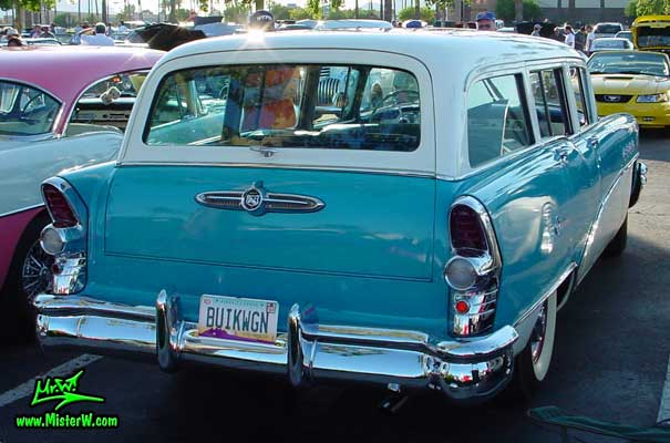 Photo of a turquoise 1955 Buick Stationwagon at the Scottsdale Pavilions Classic Car Show in Arizona. 1955 Buick Stationwagon Rearview
