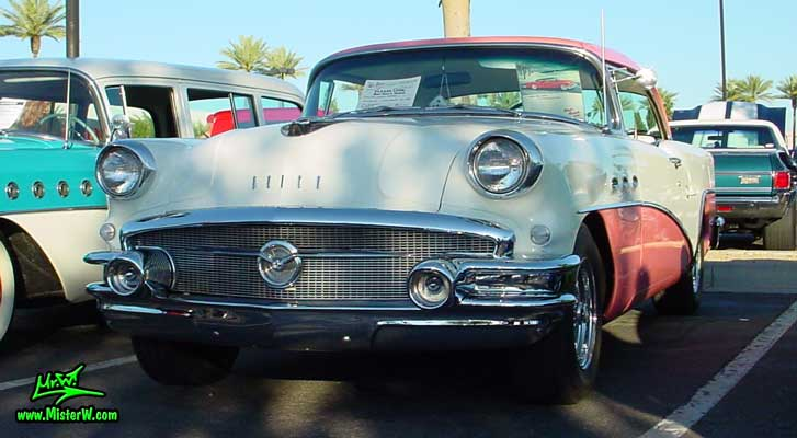 Photo of a white & pink 1956 Buick 2 Door Hardtop Coupe at the Scottsdale Pavilions Classic Car Show in Arizona. White & Pink 1956 Buick Coupe