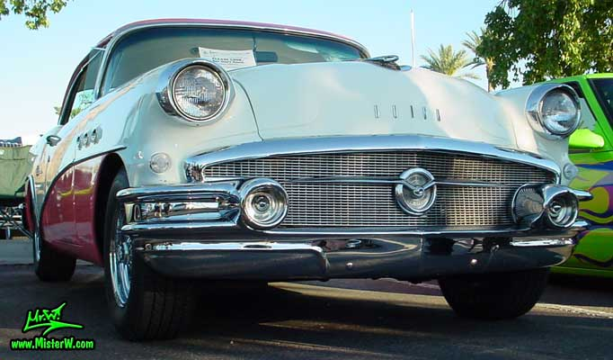 Photo of a white & pink 1956 Buick 2 Door Hardtop Coupe at the Scottsdale Pavilions Classic Car Show in Arizona. 1956 Buick 2 Door