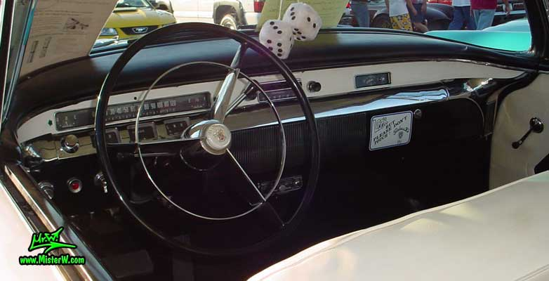Photo of a white & pink 1956 Buick 2 Door Hardtop Coupe at the Scottsdale Pavilions Classic Car Show in Arizona. 1956 Buick Interior & Dash Board
