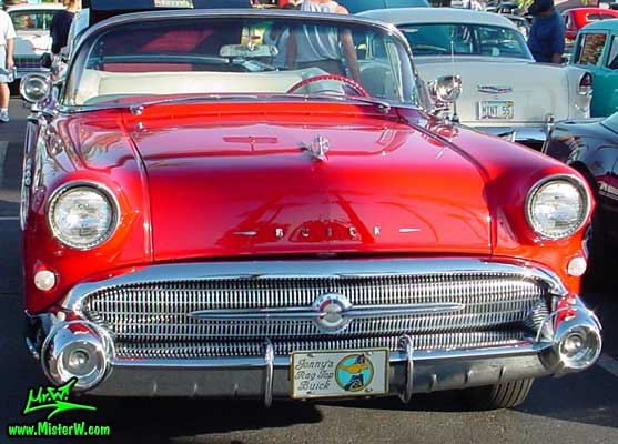 Photo of a white & red 1957 Buick Roadmaster Convertible at the Scottsdale Pavilions Classic Car Show in Arizona. Red 1957 Buick Roadmaster Convertible