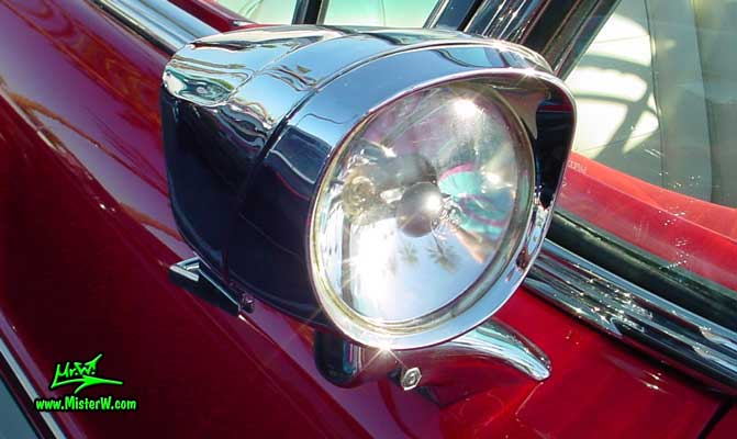 Photo of a white & red 1957 Buick Roadmaster Convertible at the Scottsdale Pavilions Classic Car Show in Arizona. 1957 Buick Searchlight