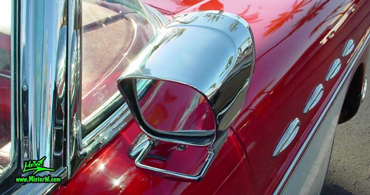 Photo of a white & red 1957 Buick Roadmaster Convertible at the Scottsdale Pavilions Classic Car Show in Arizona. 1957 Buick Passenger Side Rear View Mirror