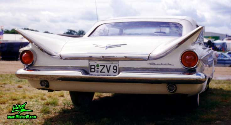 Photo of a white 1959 Buick Convertible at a classic car meeting in Germany. 1959 Buick Convertible Tail Fins