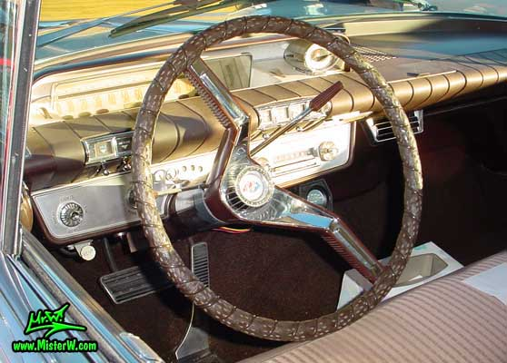 Photo of a white & brown 1960 Buick 4 Door Hardtop Sedan at the Scottsdale Pavilions Classic Car Show in Arizona. 1960 Buick Dashboard & Odometer