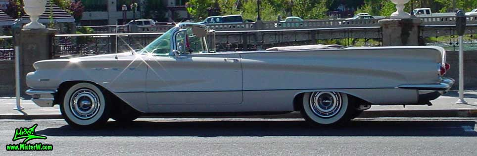Photo of a white 1960 Buick Invicta Convertible in Reno, Nevada. 1960 Buick Invicta Convertible with the top down