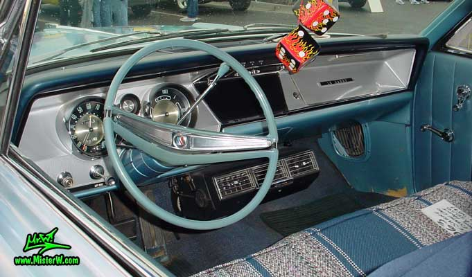 Photo of a powder blue 1963 Buick LeSabre 2 door hardtop coupe at the Scottsdale Pavilions Classic Car Show in Arizona. Interior, dashboard & speedometer of a 1963 Buick LeSabre hardtop coupe