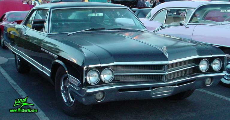 Photo of a black 1965 Buick Electra 2 Door Hardtop Coupe at the Scottsdale Pavilions Classic Car Show in Arizona. 1965 Buick Electra Coupe