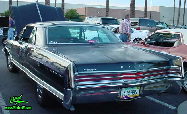Photo of a black 1965 Buick Electra 2 Door Hardtop Coupe at the Scottsdale Pavilions Classic Car Show in Arizona. Black 1965 Buick Electra