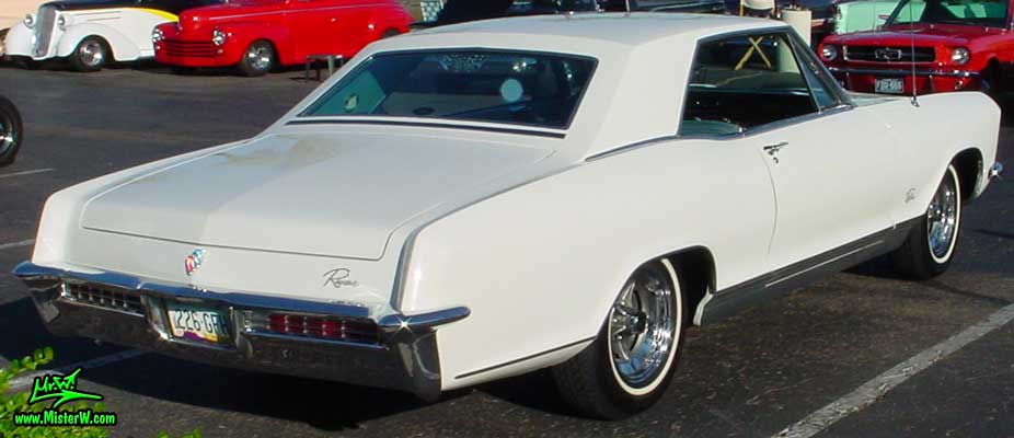 Photo of a white 1965 Buick Riviera 2 Door Hardtop Coupe at the Scottsdale Pavilions Classic Car Show in Arizona. 1965 Buick Riviera Coupe
