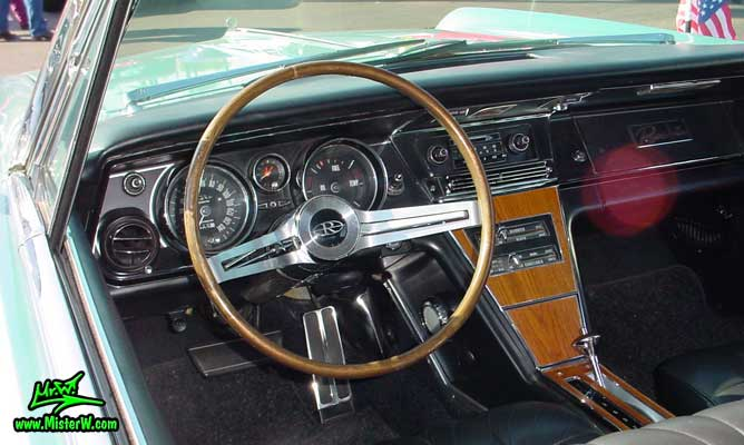 Photo of a mint green 1965 Buick Riviera 2 door hardtop coupe at the Scottsdale Pavilions Classic Car Show in Arizona. Dash board & speedometer of a 1965 Buick Riviera hardtop coupe