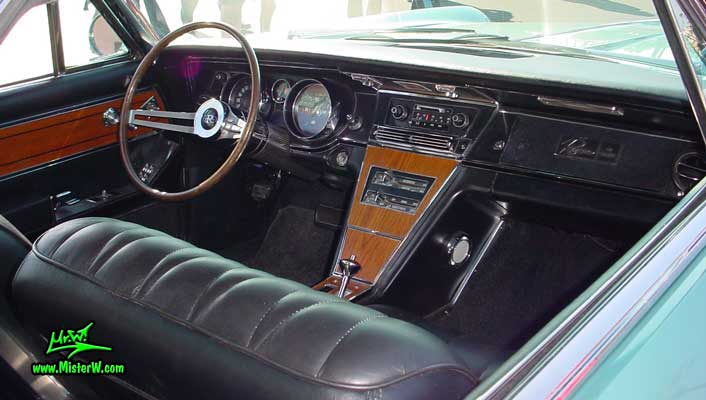 Photo of a mint green 1965 Buick Riviera 2 door hardtop coupe at the Scottsdale Pavilions Classic Car Show in Arizona. Interior & dashboard of a 1965 Buick Riviera hardtop coupe