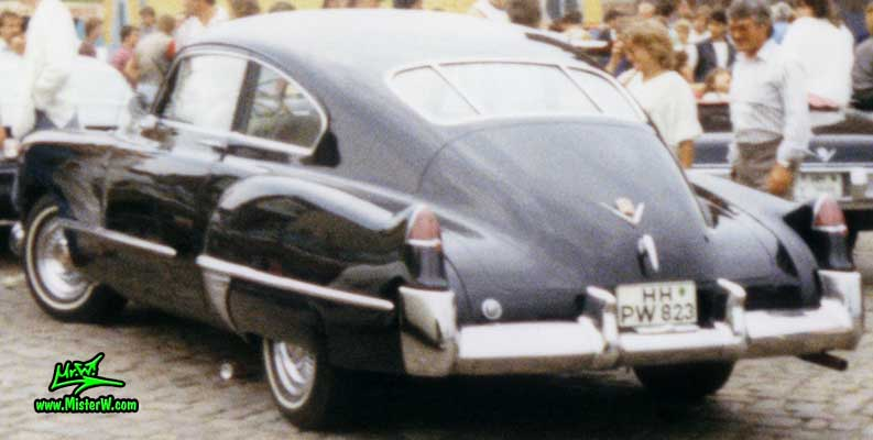 Photo of a black 1948 Cadillac Series 61 Sedanet Coupe 2 Door Fastback at the Fischmarkt classic car meeting in Hamburg, Germany. 1948 Cadillac Sedanet