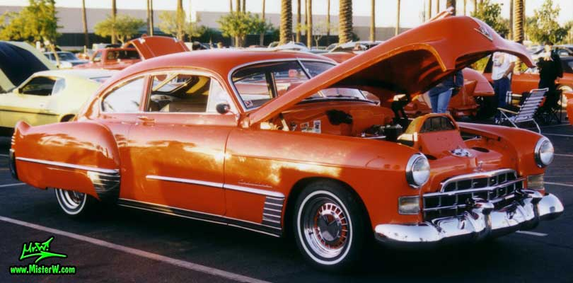 Photo of a red 1948 Cadillac Series 62 Sedanet 2 door fastback coupe at the Scottsdale Pavilions Classic Car Show in Arizona. Red 1948 Cadillac