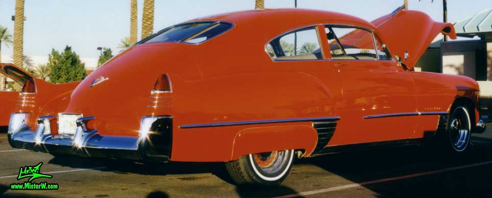 Photo of a red 1948 Cadillac Series 62 Sedanet 2 door fastback coupe at the Scottsdale Pavilions Classic Car Show in Arizona. Red 1948 Cadillac Series 62 Sedanet coupe 2 door fastback