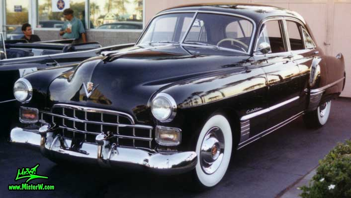 Photo of a black 1948 Cadillac Series 62 Sedan 4 Door Hardtop at the Scottsdale Pavilions Classic Car Show in Arizona. 1948 Cadillac Series 62 Sedan 4 Door Hardtop