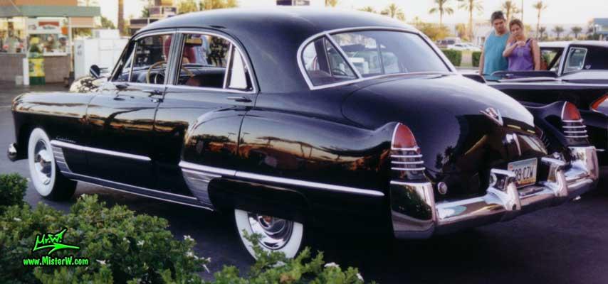 Photo of a black 1948 Cadillac Series 62 Sedan 4 Door Hardtop at the Scottsdale Pavilions Classic Car Show in Arizona. Black 1948 Cadillac Sedan