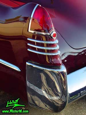 Photo of a maroon 1948 Cadillac Series 62 Sedanet 2 door fastback coupe at the Scottsdale Pavilions Classic Car Show in Arizona. 1948 Cadillac Tail Fin