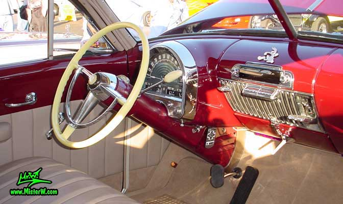 Photo of a maroon 1948 Cadillac Series 62 Sedanet 2 door fastback coupe at the Scottsdale Pavilions Classic Car Show in Arizona. 1948 Cadillac Dashboard