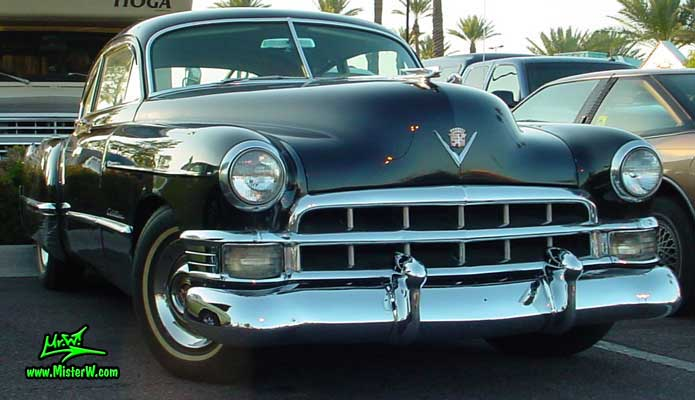 Photo of a black 1949 Cadillac Series 61 Sedanet 2 door fastback coupe at the Scottsdale Pavilions Classic Car Show in Arizona. Black 1949 Cadillac