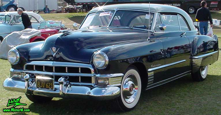 Photo of a midnight blue 1949 Cadillac Series 62 Coupe De Ville 2 door hardtop at a classic car auction in Scottsdale, Arizona. 1949 Cadillac Series 62 Coupe De Ville