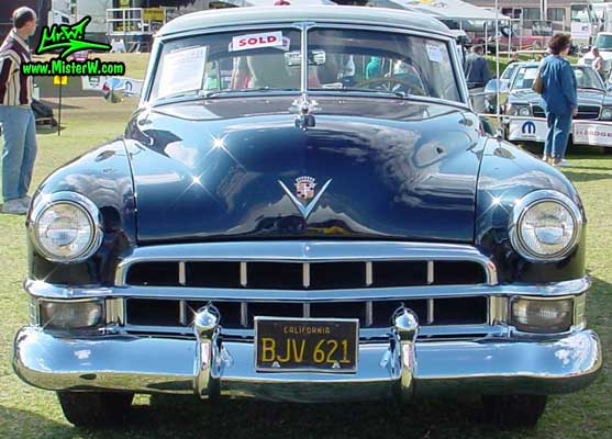 Photo of a midnight blue 1949 Cadillac Series 62 Coupe De Ville 2 door hardtop at a classic car auction in Scottsdale, Arizona. 1949 Cadillac chrome front grill