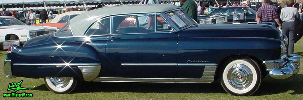 Photo of a midnight blue 1949 Cadillac Series 62 Coupe De Ville 2 door hardtop at a classic car auction in Scottsdale, Arizona. Midnight blue 1949 Cadillac Series 62 Coupe DeVille 2 door hardtop sideview
