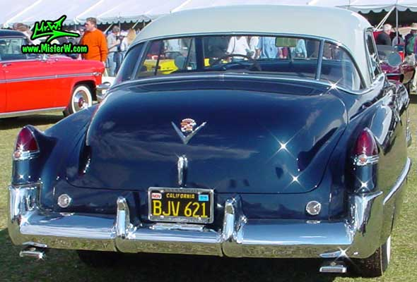 Photo of a midnight blue 1949 Cadillac Series 62 Coupe De Ville 2 door hardtop at a classic car auction in Scottsdale, Arizona. 1949 Cadillac rearview