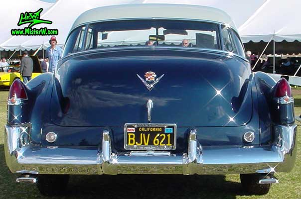Photo of a midnight blue 1949 Cadillac Series 62 Coupe De Ville 2 door hardtop at a classic car auction in Scottsdale, Arizona. 1949 Cadillac rear bumper & tail fins