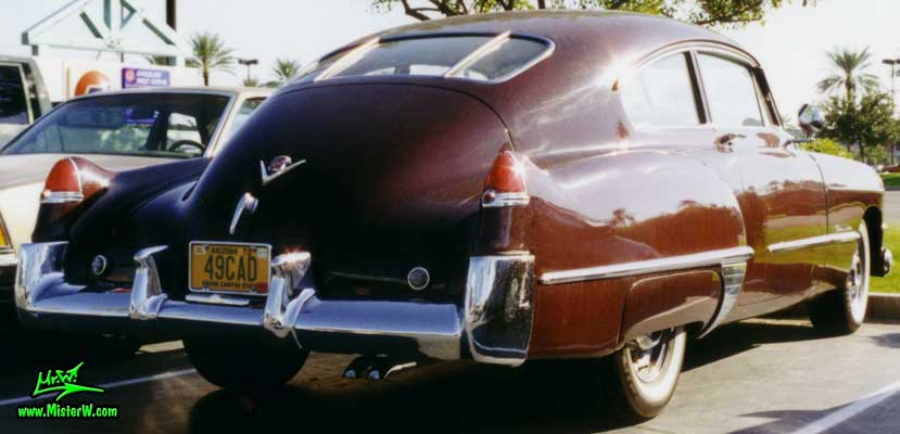 Photo of a coffee brown 1949 Cadillac Series 61 Sedanet fastback 2 door coupe at the Scottsdale Pavilions Classic Car Show in Arizona. Coffee brown 1949 Cadillac