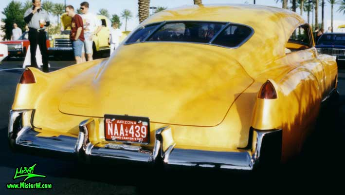 Photo of a powder yellow 1949 Custom Cadillac Sedanet 2 door fastback coupe at the Scottsdale Pavilions Classic Car Show in Arizona. Powder yellow 1949 Cadillac Leadsled