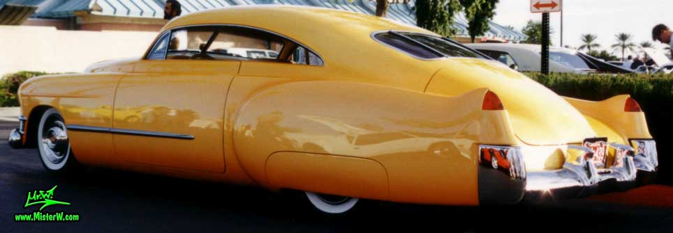 Photo of a powder yellow 1949 Custom Cadillac Sedanet 2 door fastback coupe at the Scottsdale Pavilions Classic Car Show in Arizona. Chopped & lLowered 1949 Cadillac