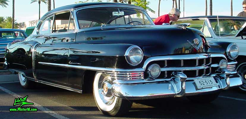 Photo of a black 1950 Cadillac Series 62 Coupe 2 Door Hardtop at the Scottsdale Pavilions classic car show in Arizona. Black 1950 Cadillac Series 62