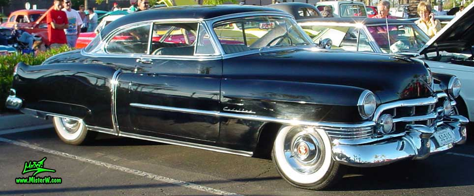 Photo of a black 1950 Cadillac Series 62 Coupe 2 Door Hardtop at the Scottsdale Pavilions classic car show in Arizona. 1950 Cadillac Coupe