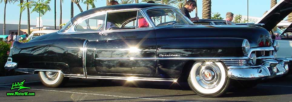 Photo of a black 1950 Cadillac Series 62 Coupe 2 Door Hardtop at the Scottsdale Pavilions classic car show in Arizona. black 50 Cadillac Coupe