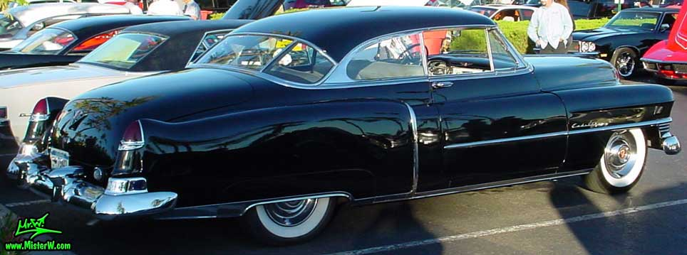 Photo of a black 1950 Cadillac Series 62 Coupe 2 Door Hardtop at the Scottsdale Pavilions classic car show in Arizona. 1950 Cadillac Fins