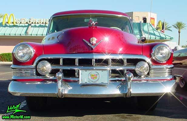 Photo of a cherry red 1950 Cadillac Series 62 4 door sedan at the Scottsdale Pavilions classic car show in Arizona. 1950 Cadillac Series 62 Sedan