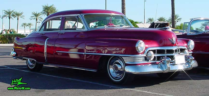 Photo of a red 1950 Cadillac Series 62 Sedan 4 Door Hardtop at the Scottsdale Pavilions classic car show in Arizona. 1950 Cadillac 4 Door Hardtop