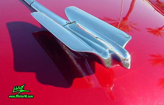 Photo of a cherry red 1950 Cadillac Series 62 4 door sedan at the Scottsdale Pavilions classic car show in Arizona. 1950 Cadillac hood ornament